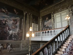 Grand stairway with wall art